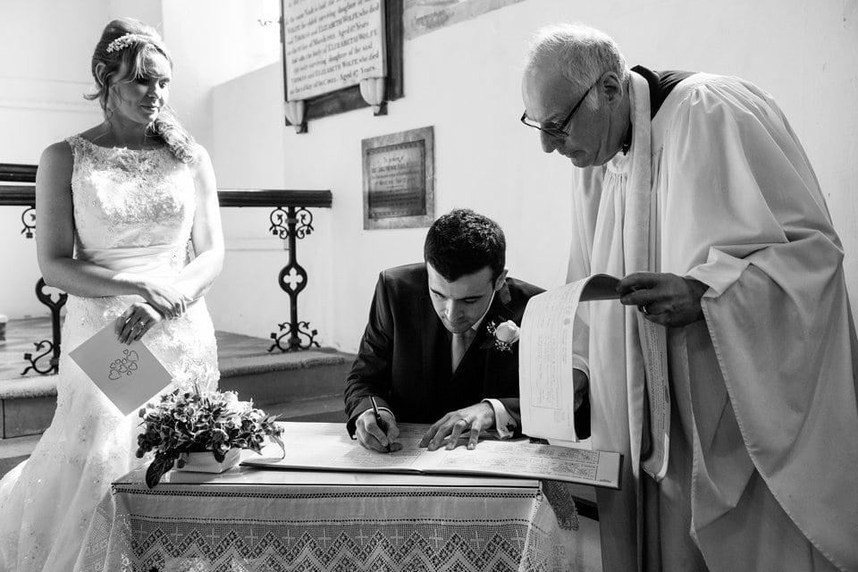 007-signing-register-church-Tori-Deslauriers