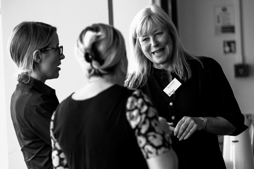 corporate businesswomen laughing while networking