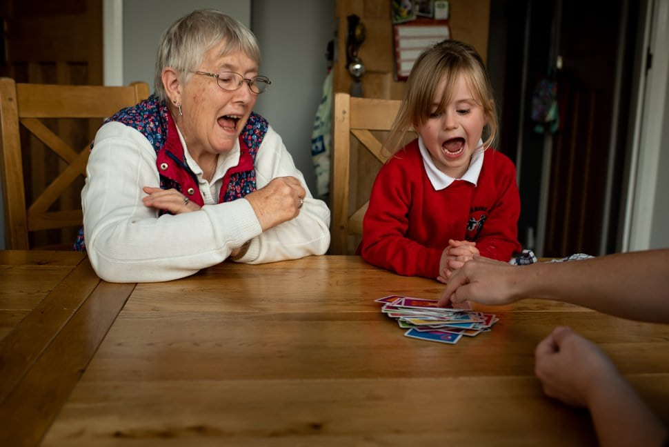 playing snap card game with granny