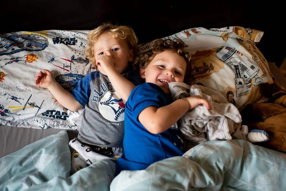 brothers having a nap during family photoshoot st albans