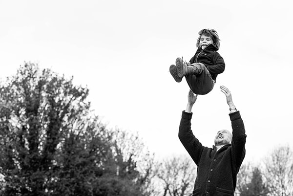 dad throwing son, outdoor family photo session, St Albans family photographer