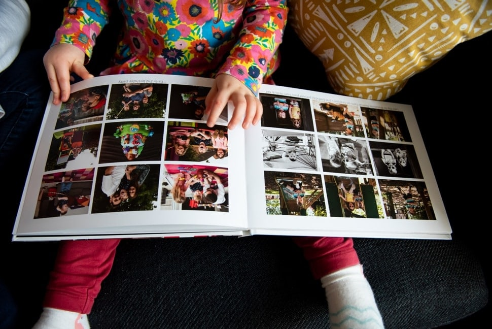 child looking at family photo album