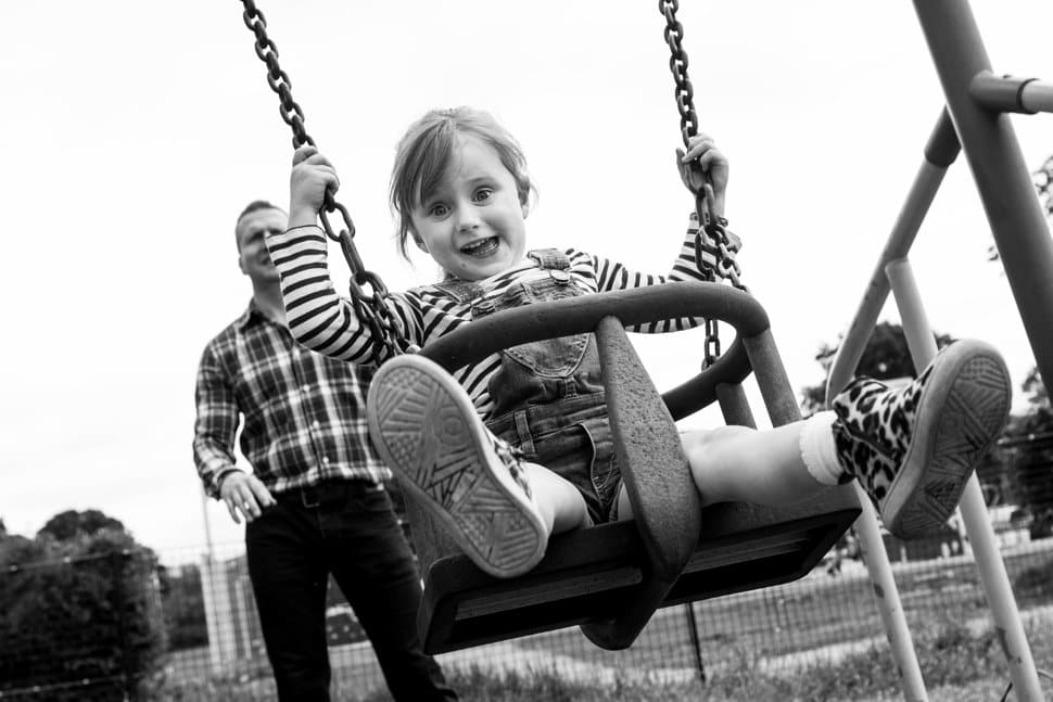 happy girl on swing in St Albans park
