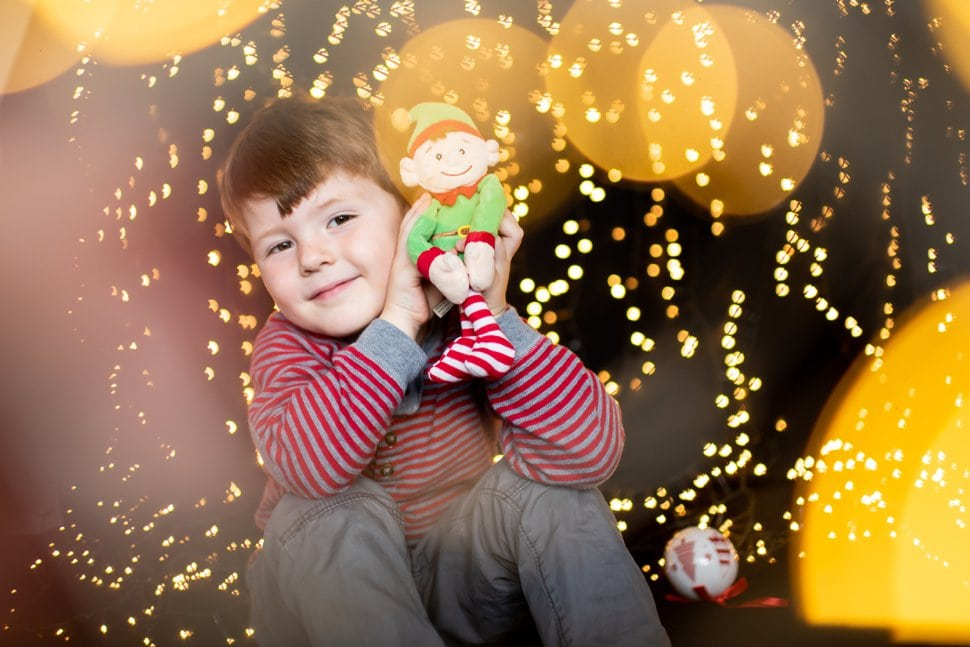 boy with elf and christmas twinkly lights