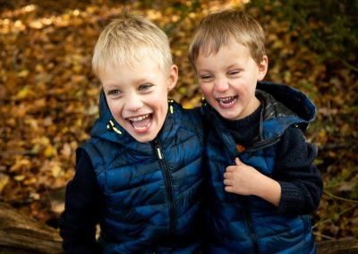 laughing brothers in the autumn woods