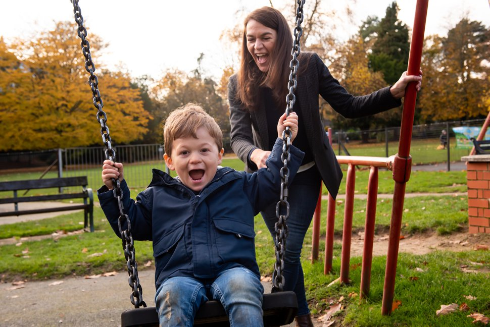 mum pushing her son on a swing in Clarence Park, St Albans