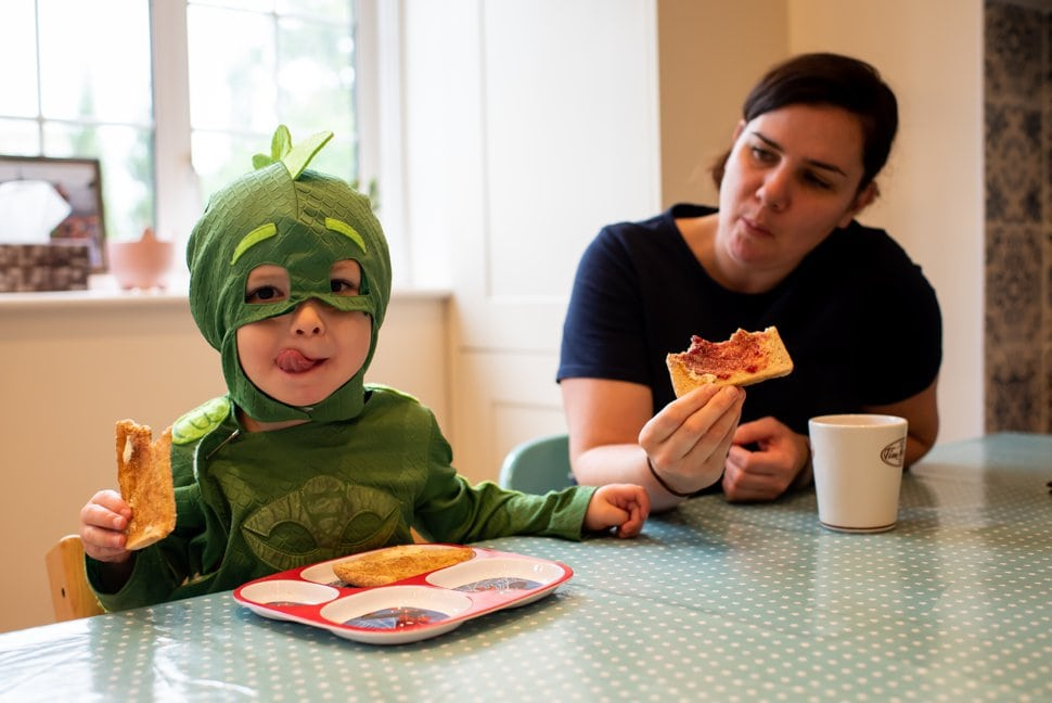 boy eats breakfast in halloween costume