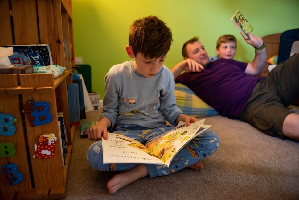 boy in pajamas reads bedtime story at home in st albans
